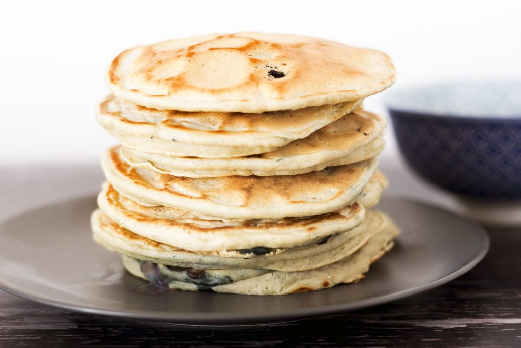 stack of vegan eggless pancakes on grey plate