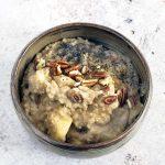 overhead shot of apple and cinnamon porridge in ceramic brown bowl