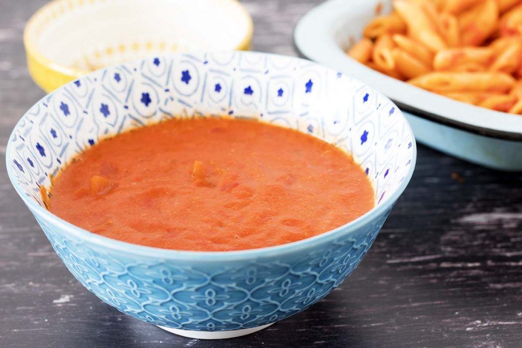 creamy tomato sauce in blue and white bowl