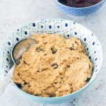 healthy cookie dough made from chickpeas in blue and white bowl