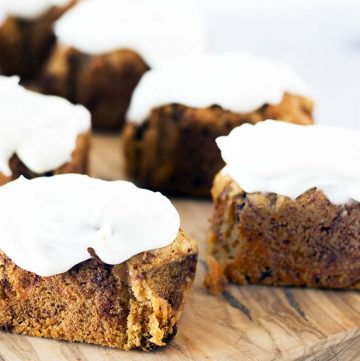 vegan carrot loaf cakes with cream cheese frosting on wooden board