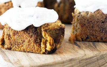 small carrot loaf cakes on wooden board with frosting