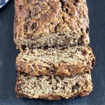 healthy vegan banana bread on slate plate, sliced