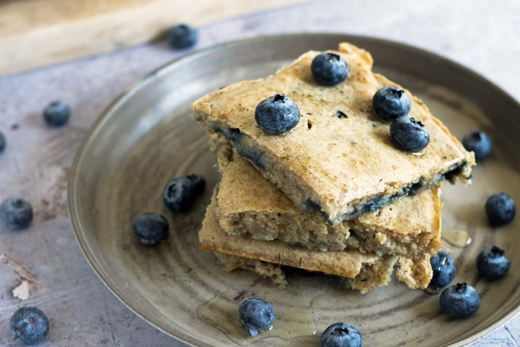 oven baked pancakes with blueberries on plate