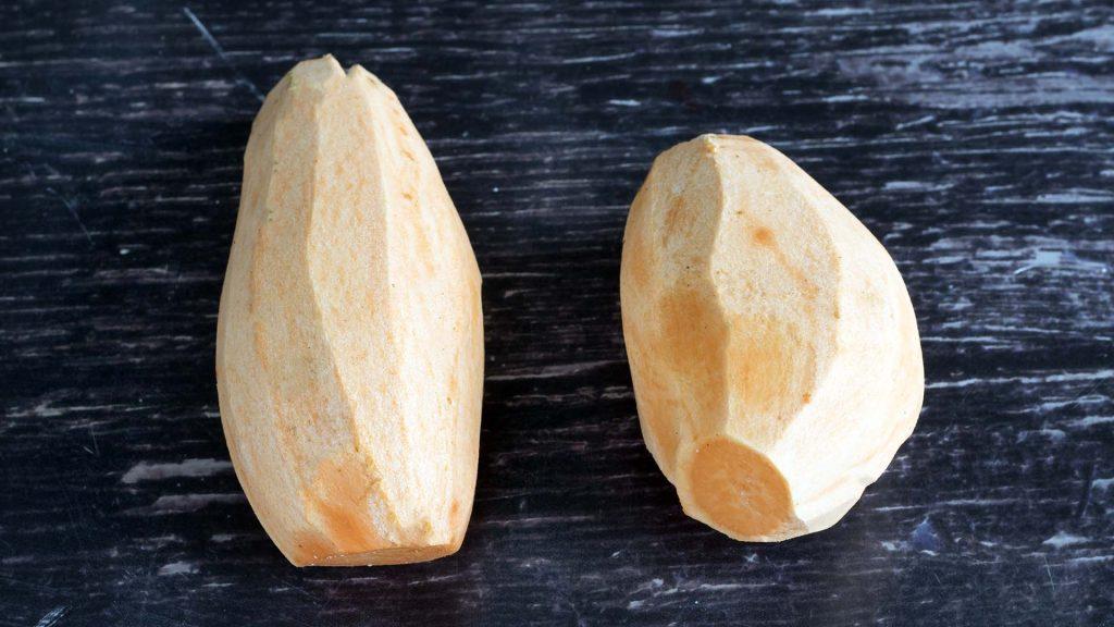 two peeled sweet potatoes