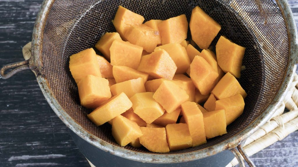 cooked sweet potato in sieve