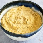 butternut squash hummus in blue and white ceramic bowl