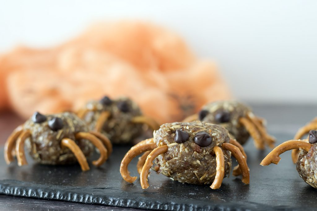 Spider energy balls on black slate with orange web in background