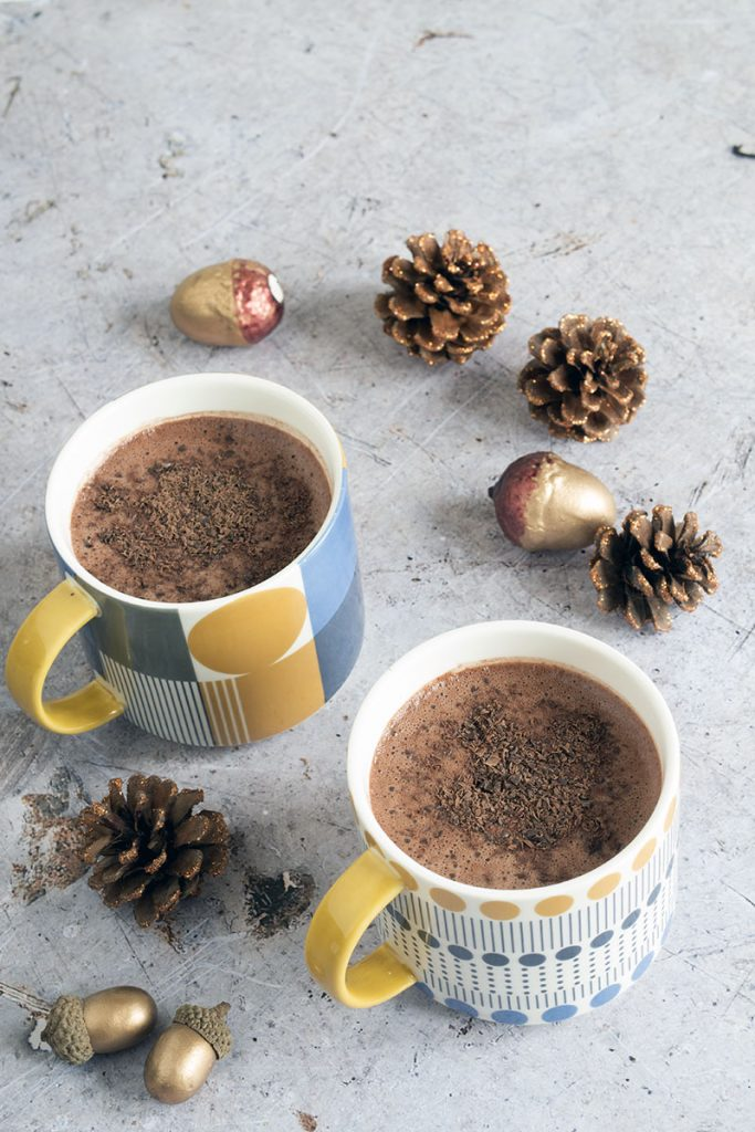 vegan healthy hot chocolate with almond milk on grey background
