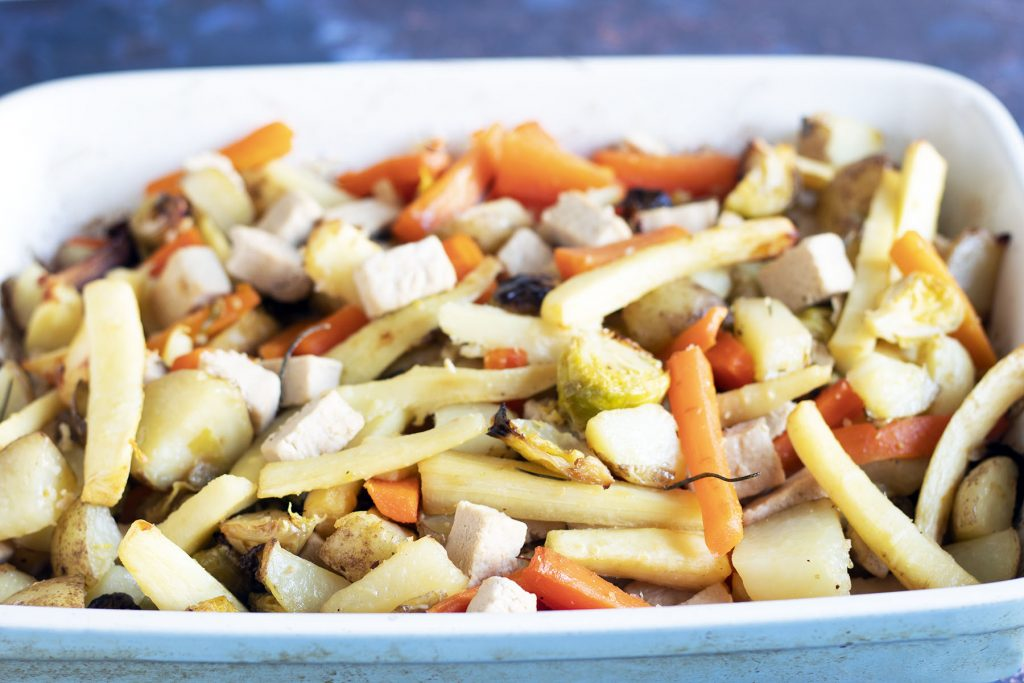 roasting tin with carrots, parsnips, potatoes, brussels sprouts and quorn chicken