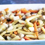 blue and white roasting dish with christmas vegetables