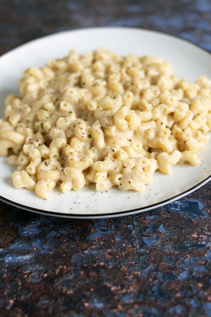 portrait shot of pasta with cauliflower sauce on white plate