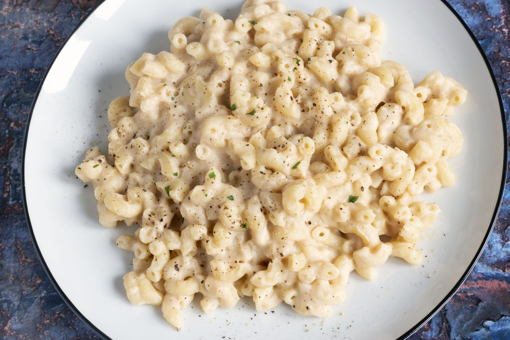 cauliflower pasta sauce with macaroni on white plate