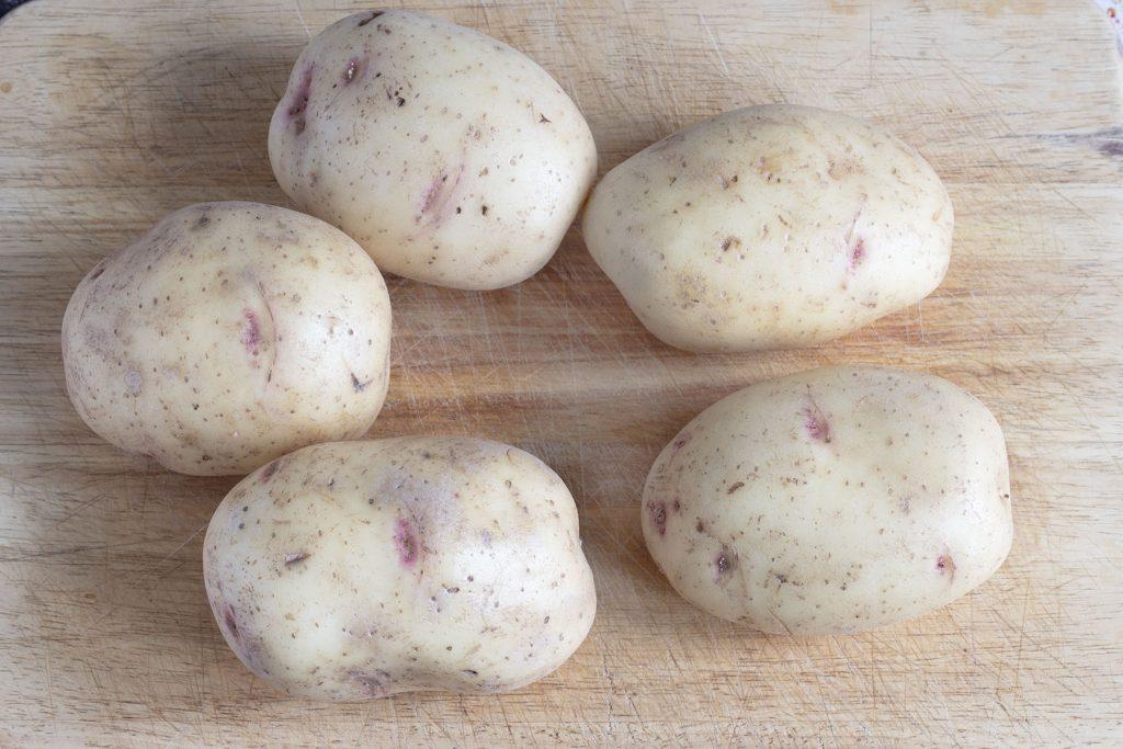 five uncooked jacket potatoes