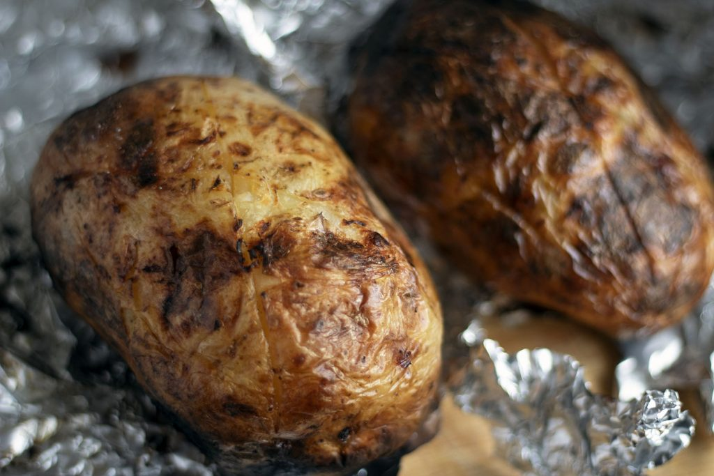 barbecued potatoes on foil