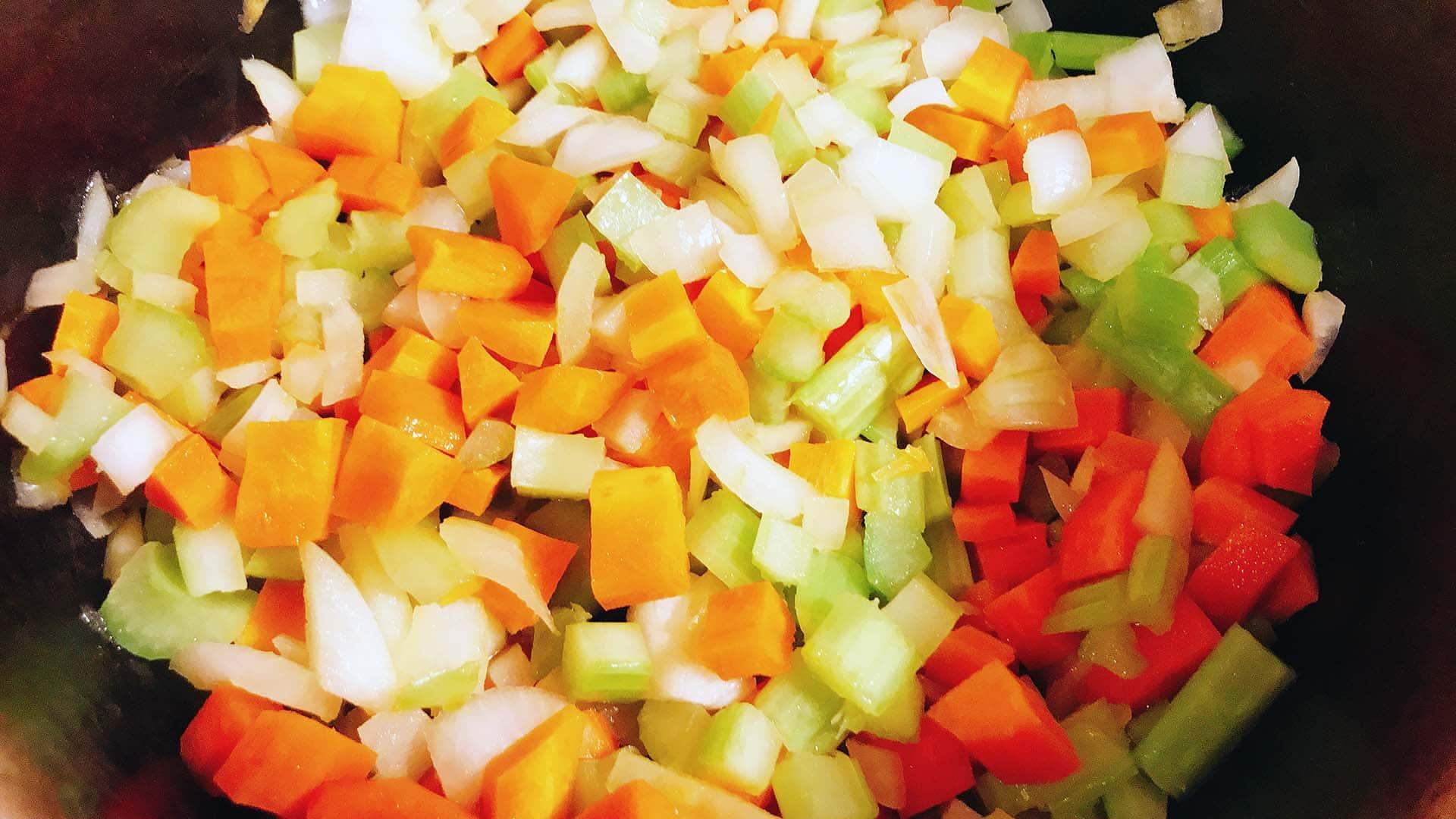 carrot, onion, celery in pan