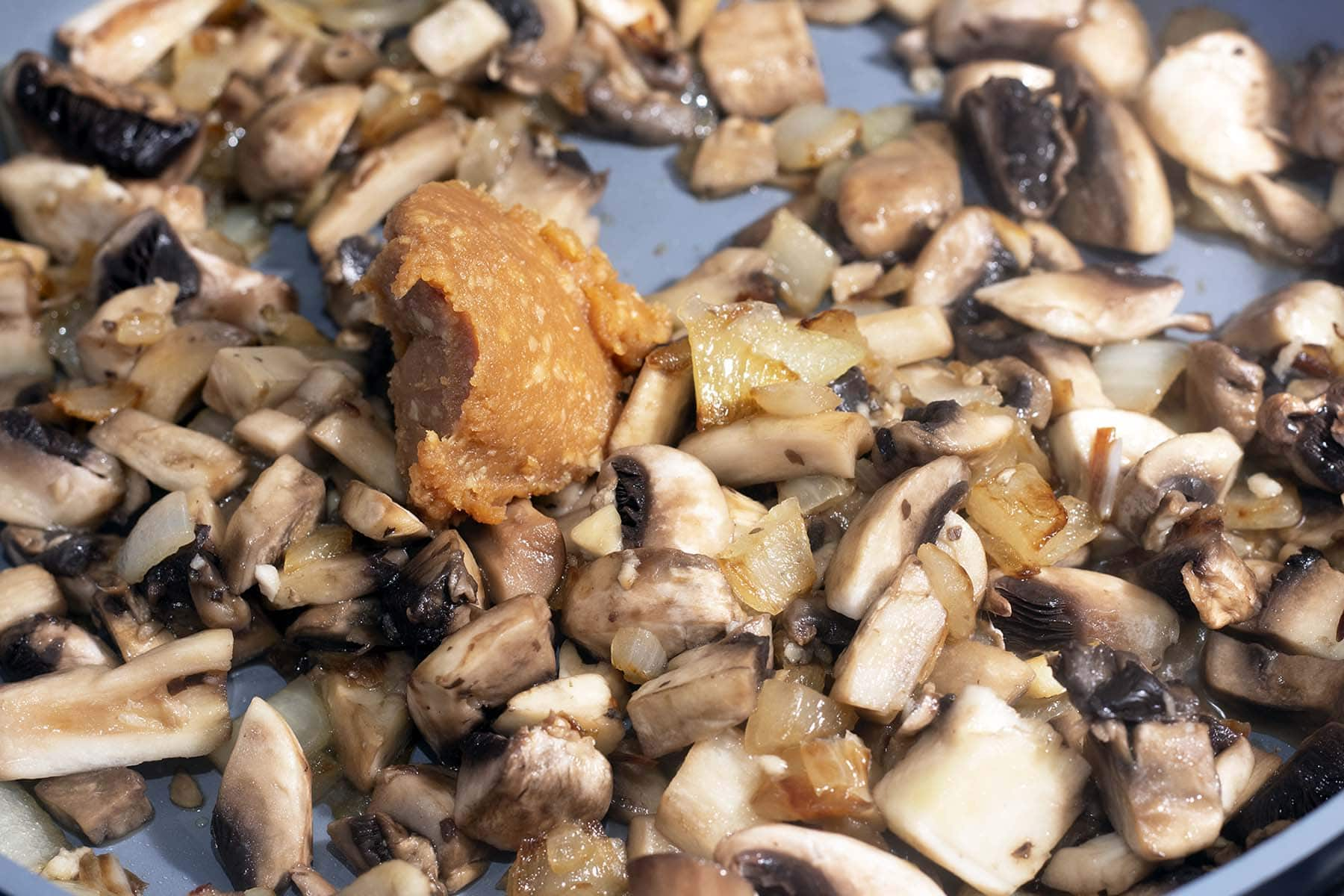 mushrooms and miso paste in pan