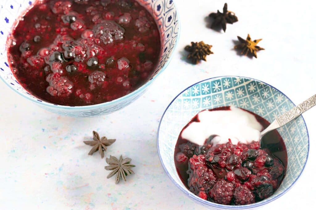 bowls of purple stewed fruit with star anise