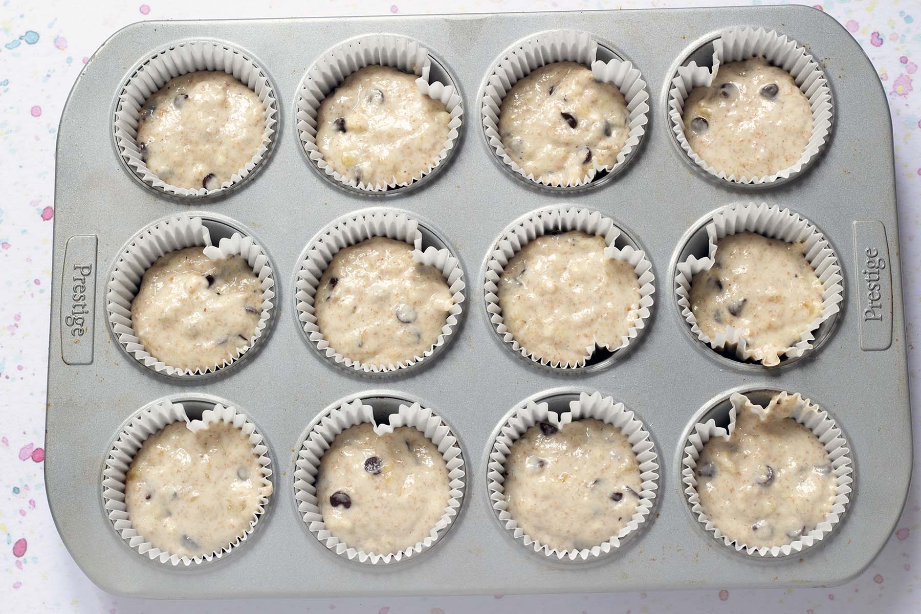 unbaked muffins in cases