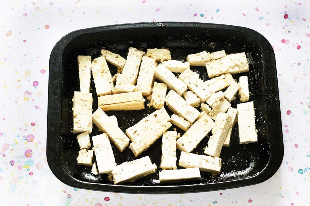 baked tofu in black roasting tin