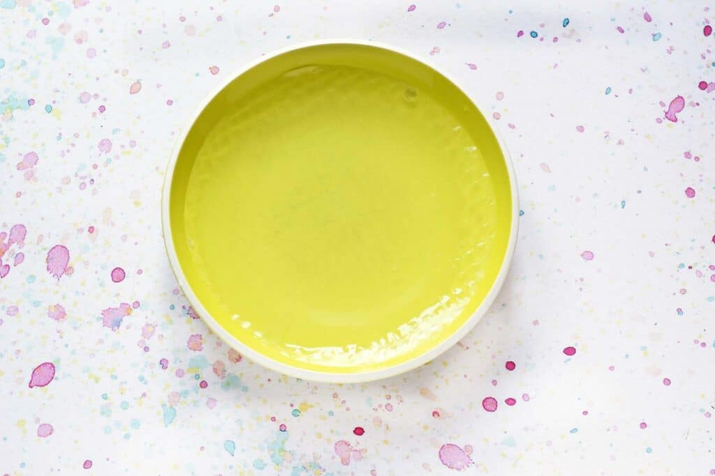green bowl with water and rice paper wrapper