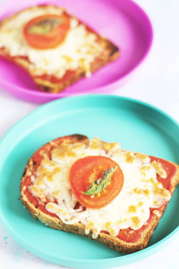 pizza toast on pink and green plates