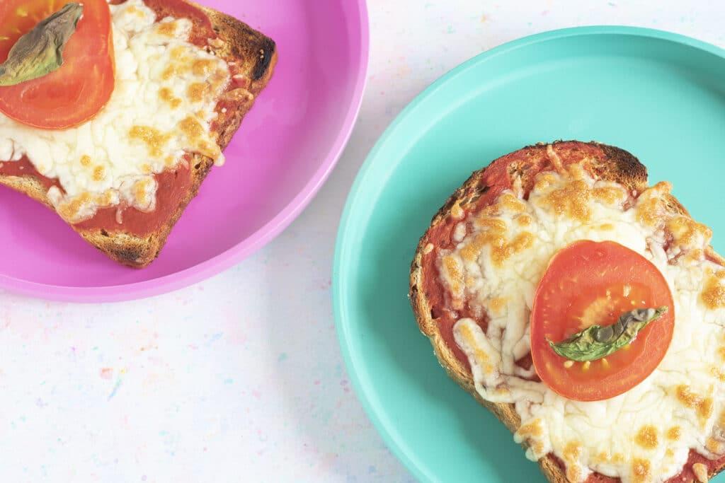 pizza toast on colourful plates